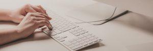 woman writing mail on keyboard